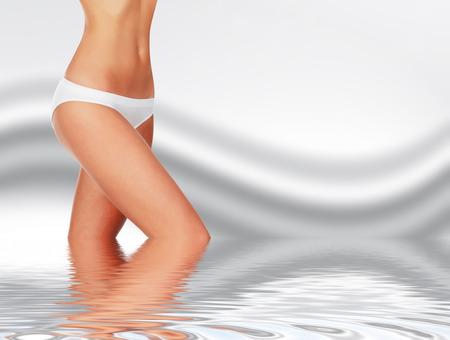 Slim woman against abstract background Standard-Bild