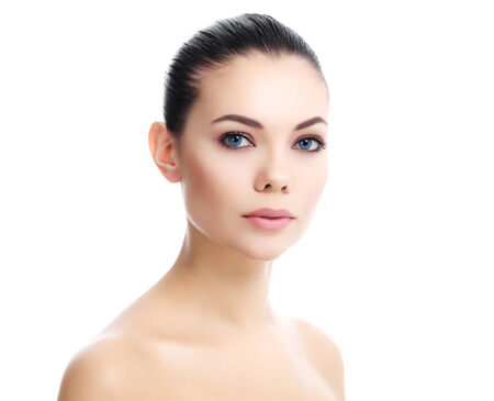 Beautiful girl with clean fresh skin, white background  photo
