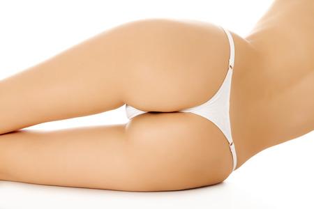Female backside, white background. photo