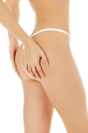 nalga: Parte trasera femenina, fondo blanco.