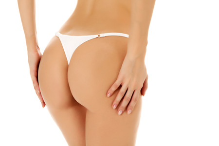 Female butt, white background, copyspace photo