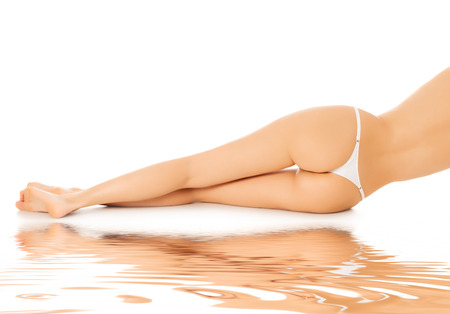 Female legs, veiw from behind, white background photo