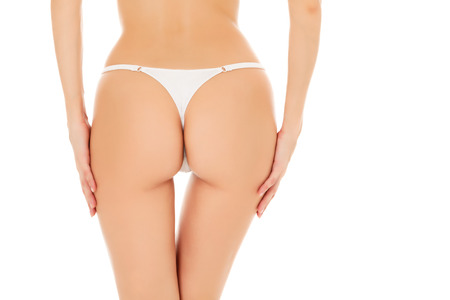Female butt, white background  photo