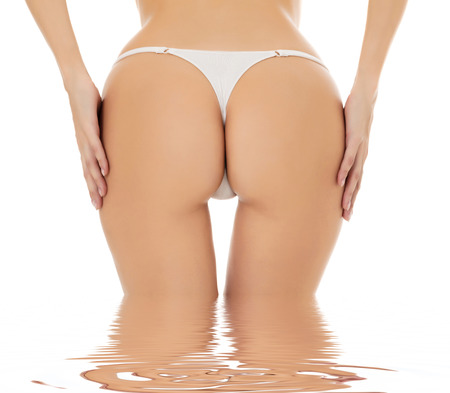 thong woman: Female butt, white background  Stock Photo