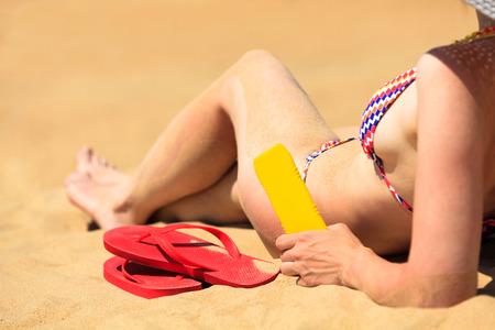 Woman sitting on a sandy beach photo