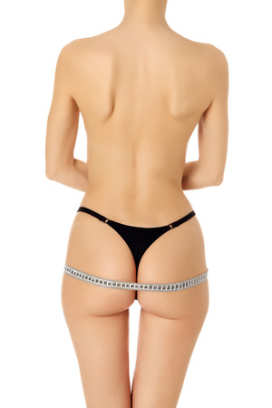 sexy woman panties: Woman measures her body, white background, copyspace