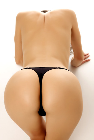 nude ass: Female ass, white background, copyspace