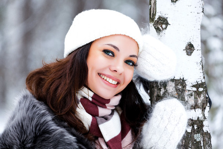 Happy woman in a winter forest photo