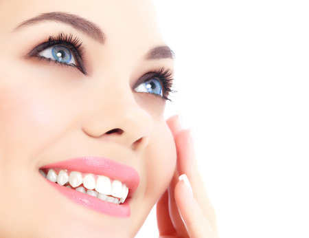clear skin: Cheerful female with fresh clear skin, white background.  Stock Photo