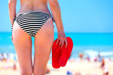 blue bikini: Woman on a beach