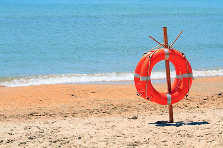 lifebuoy on a beach photo