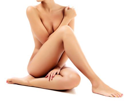 Naked female body, white background, isolated Stock Photo