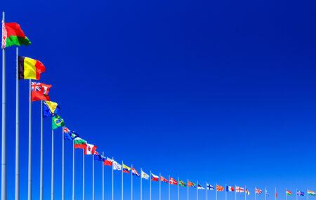 Flags against blue sky, copyspace photo