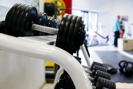staying in shape: Dumbells in a gym