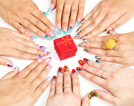 Female hands with various nail arts photo