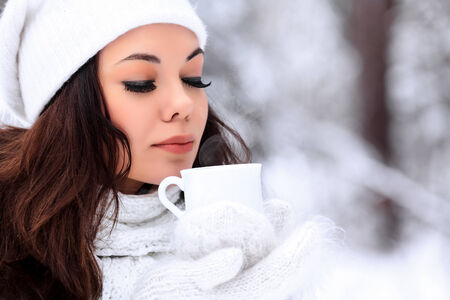 evaporate: woman with a cup of hot tea posing outdoors