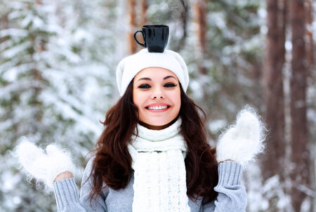 evaporate: Happy woman with a cup of hot tea on her head