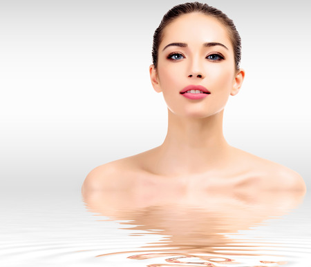 Beautiful young female with clean fresh skin Standard-Bild