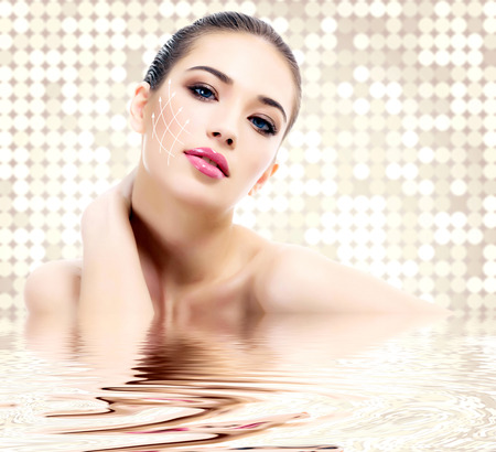 Young female with clean fresh skin, abstract background