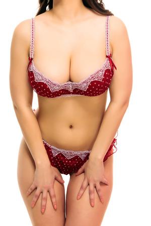 big boobs: Mujer atractiva en un traje de ba�o, fondo blanco, aislado, copyspace Foto de archivo