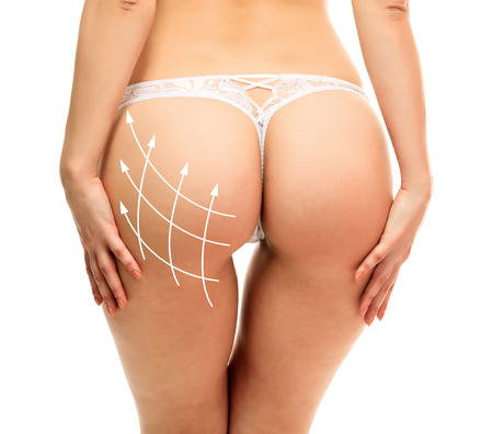 strings: Female butt, white background Stock Photo