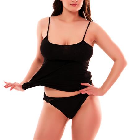 femme noire nue: Femme avec corps sexy posant sur un fond blanc