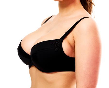 Mujer con grandes pechos, fondo blanco, aislado, copyspace