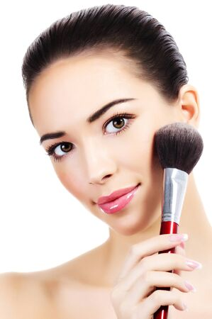 make up brush: Beautiful girl with a makeup brush, white background, isolated