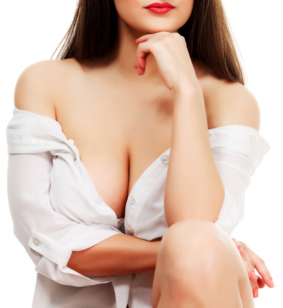 boobs: Busty woman in white shirt, white background, isolated, copyspace Stock Photo