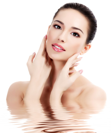 clear skin: Beautiful female with fresh clear skin, white background, isolated