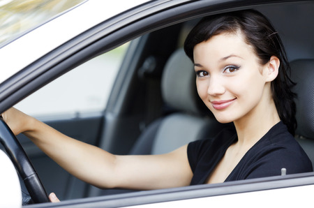female driver: Pretty female driver in a white car Stock Photo