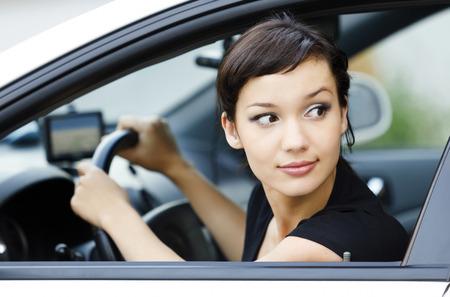 Girl parking a car Standard-Bild