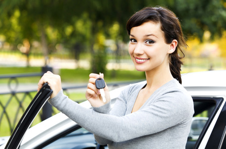 car keys: Pretty girl showing the car key