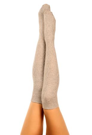 long socks: Long female legs in knitted socks, white background, isolated