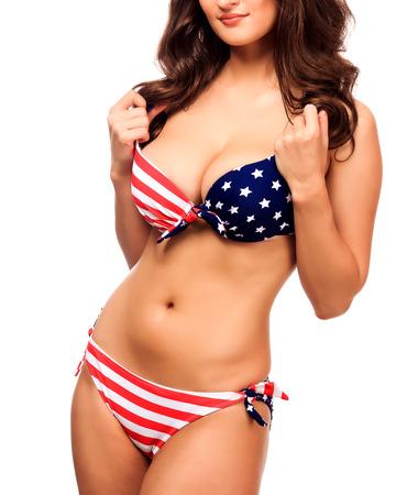 big boobs: Mujer atractiva en traje de baño con los colores de la bandera USA, aislado en blanco