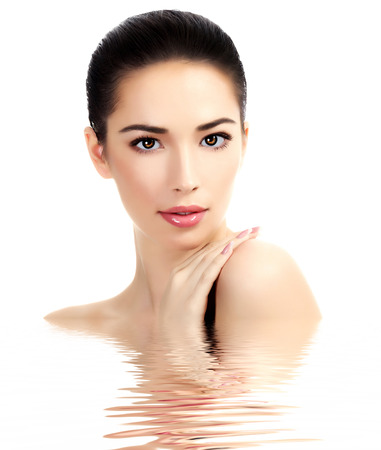 cosmetic surgery: Beautiful face of young adult woman with clean fresh skin, white background, isolated, copyspace