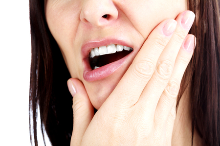 Woman with a toothpain, isolated on white Stockfoto