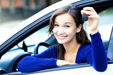 drive car: Cute girl shows a car key