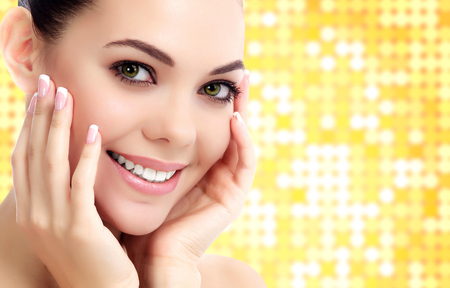 clear skin: Cheerful female with fresh clear skin, bright background with circles Stock Photo