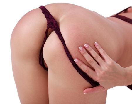 mujer desnuda: La mujer tira de sus bragas, fondo blanco, aislado