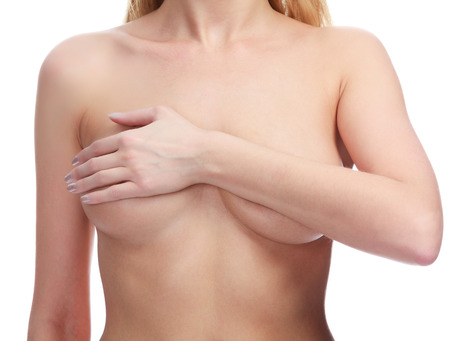 nude breast: Female controlling breast for cancer, isolated on white Stock Photo
