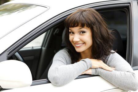 driver: Pretty female driver in a white car Stock Photo