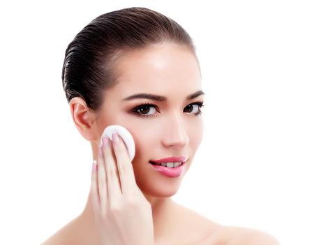 Woman uses cotton pad