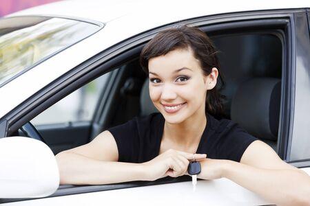 rental: Pretty girl in a car showing the key