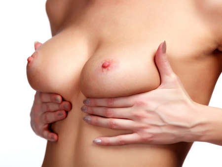 anatomy naked woman: Female controlling breast for cancer, isolated on white Stock Photo