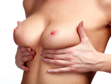 beaux seins: Sein chez la femme contrôle du cancer, isolé sur blanc