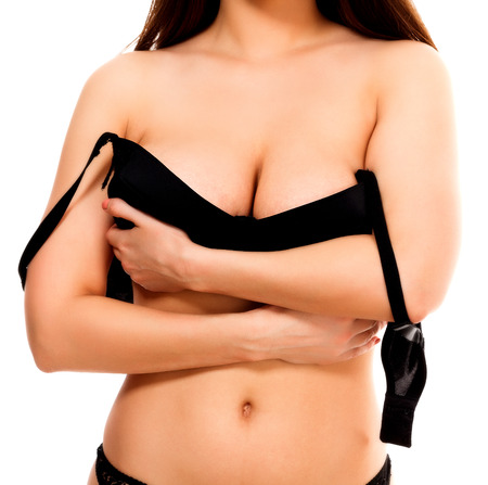 nice breast: Woman holds her bra, isolated on white background