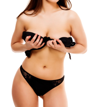 nice breast: Busty woman is about to show her boobs, isolated on white background Stock Photo