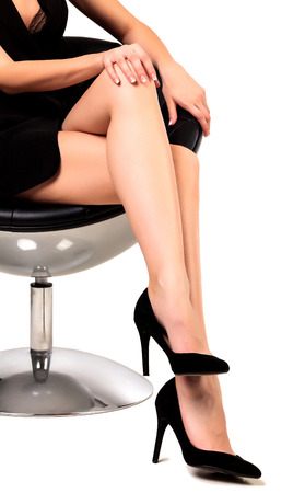 secretary skirt: Woman with long legs sitting in a chair, isolated on white background