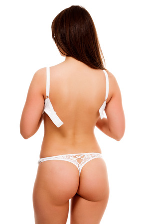 sexy nackte frau: Entkleiden Frau, isoliert auf weißem Hintergrund